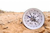 image of orientation  - Orientation Concept Metal Compass on a Rock in the Desert - JPG