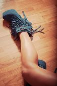 pic of ankle shoes  - long slim woman legs in blue ankle high heel fringe boot indoor shot on parquet retro colors - JPG