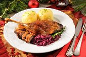 stock photo of canard  - Crusty goose leg with braised red cabbage and dumplings - JPG