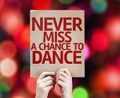 stock photo of missing  - Never Miss a Chance to Dance card with colorful background with defocused lights - JPG