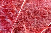 stock photo of flank steak  - Closeup macro background texture of red beef lamb meat - JPG