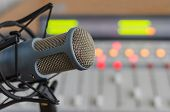 pic of microphone  - blue microphone and audio console radio studio - JPG
