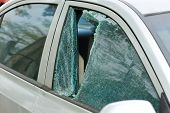 picture of car-window  - closeup of car window smashed by a thief - JPG