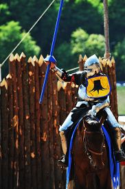 foto of jousting  - armored medieval knight on horseback at jousting competition - JPG