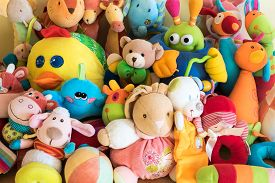 stock photo of furry animal  - Coloured soft toys in a child - JPG