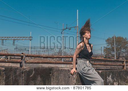 Beautiful Brunette Posing In An Industrial Context
