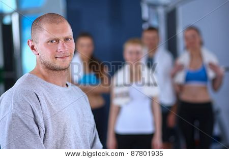 People at the gym standing together