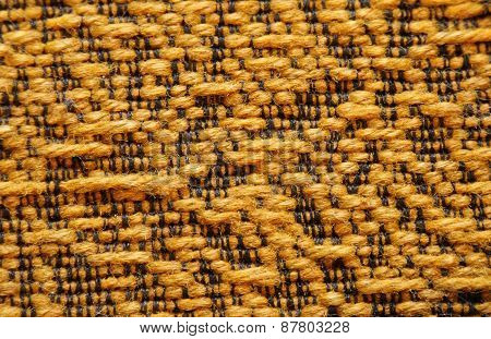 Woolen Upholstery With Orange Color With A Pattern Of Black Thread As Abstract Background