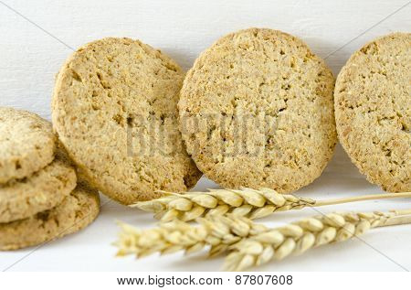 Integral Cookies And Wheat On White Background