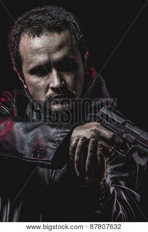 thief with gun in hand. man in leather jacket