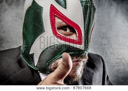angry businessman  with Mexican wrestler mask