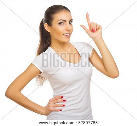 Young healthy girl shows pointing gesture isolated