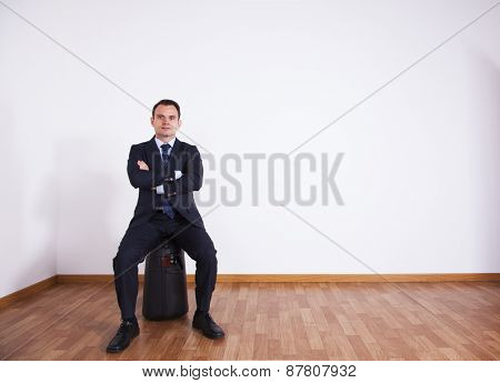 Businessman sit on his luggage
