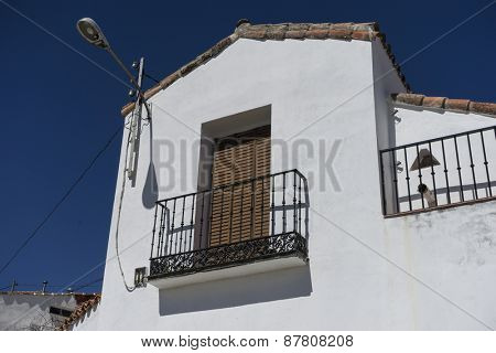 houses and typical Spanish architecture, white buildings, Mediterranean style