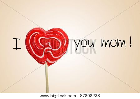 the sentence I love you mom with a red heart-shaped lollipop instead of the word love, on a beige background