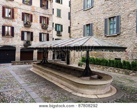 Public medieval laudry in Bergamo square