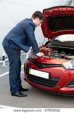 Man In Suit Looking Under Car Bonnet