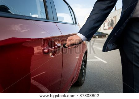 Closeup Of Businessman Pulling Car Door Handle