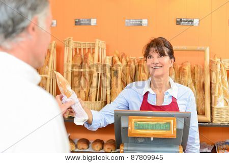 Bakery worker at the till
