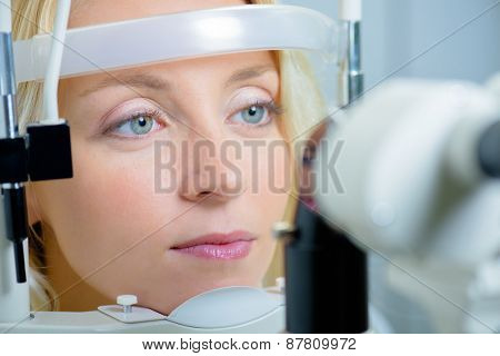 Blonde woman about to have her sight tested
