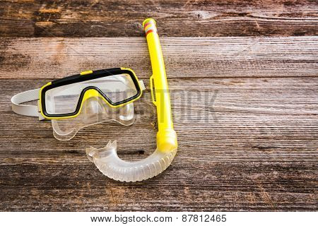 Diving stuff. Mask and snorkel diving on a wooden background