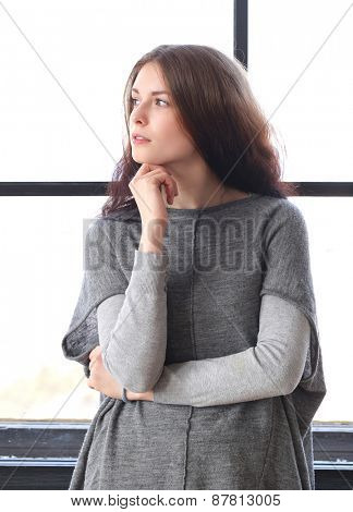 Cute girl by the window
