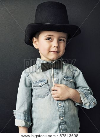Vintage style photo of a cute young boy