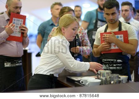 DNEPROPETROVSK, UKRAINE - MAY 30, 2013: Barista Lyubov Taran in free pouring competition during 5th Ukrainian Latte Art Championship in Dnepropetrovsk, Ukraine on May 30, 2013