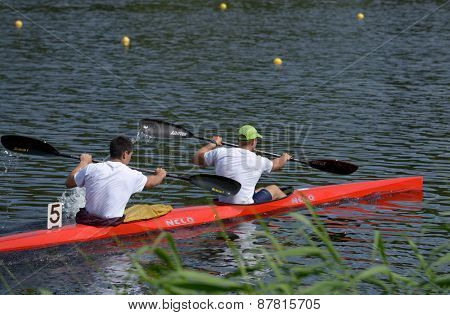 DNEPROPETROVSK, UKRAINE - MAY 29, 2013: Unidentified paddlers in the kayak racing during Ukrainian paddling championships. Dnepropetrovsk rowing canal is the main Ukrainian sport arena in kayaking