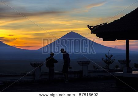 Man With And Volcano Agung As Background.