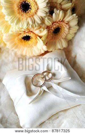 Elegant Wedding Rings On White Pillow