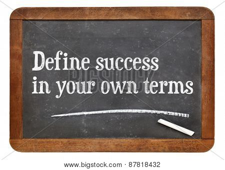Define success in your own terms - inspirational words on a vintage slate blackboard