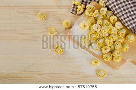 Uncooked Italian Ravioli On  Wooden Table.