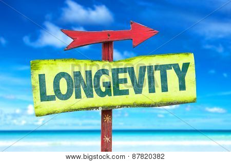 Longevity sign with beach background