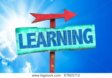 Learning sign with sky background