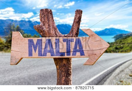 Malta wooden sign with road background