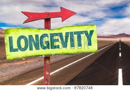 Longevity sign with road background