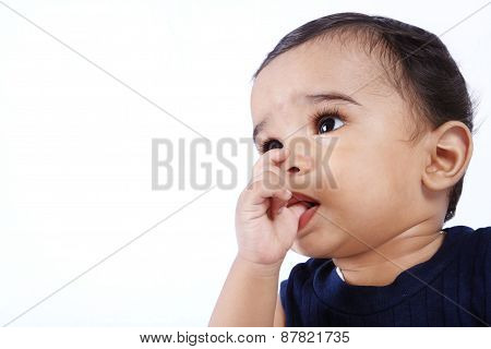 Cute Baby Sucks on His Finger