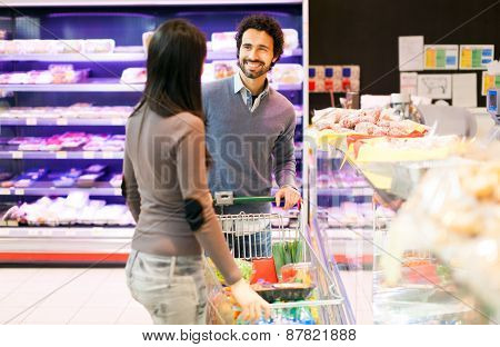 Couple shopping at the grocery store