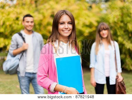 Outdoor portrait of a beautiful smiling student