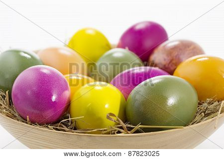 Easter eggs in a wooden bowl, shallow DOF