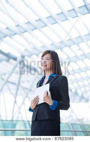 Smiling pensive business woman