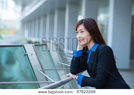 Smiling pensive business lady