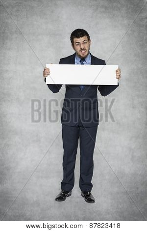 Frustrated Businessman Holding Advertisement