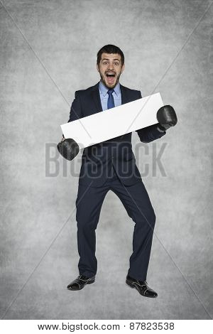 Funny Businessman In Boxing Gloves And Place For Advertisement