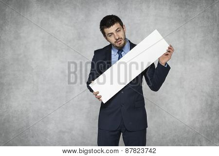 Disappointed Businessman Holds An Ad