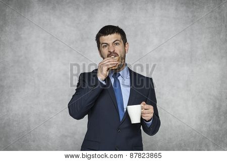 Businessman Biting A Sandwich In A Hurry