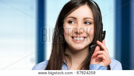 Smiling young female call center operator