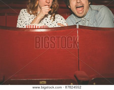 Couple Watching A Scary Film In A Movie Theater