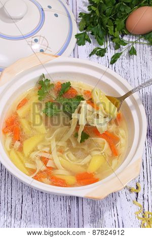 Chicken Soup With Noodles Scoop From A Soup Tureen A Spoon